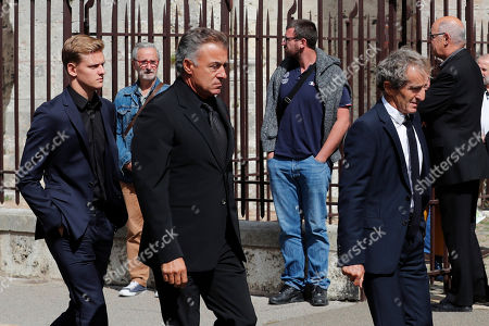 French former drivers, Alain Prost, right, Jean Alesi, center, and German F2 driver Mick Schumacher, left, arrive for the funeral ceremony of late French driver Anthoine Hubert, at the Chartres cathedral, in Chartres, south of Paris, . The French driver died at the Spa-Francorchamps track following a 160 mph (257 kph) crash in the F2 Belgian Grand Prix
