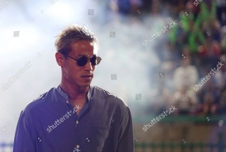 Cambodia's manager Keisuke Honda walks before the World Cup Group C qualifying soccer match between Cambodia and Bahrain in Cambodia National Stadium, in Phnom Penh, Cambodia