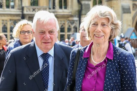 Chris Patten (L) with his wife Lavender Patten departs from Westminster Abbey in London after attending  a memorial service for Lord Paddy Ashdown. Lord Ashdown became the leader of the newly formed Liberal Democrats created by the merger of the Liberal Party and the Social Democratic Party in 1988, a position he held for 11 years before standing down in 1999.