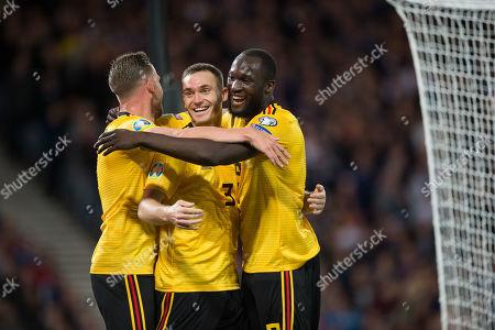 Thomas Vermaelen celebrates with Toby Alderweireld and Romelu Lukaku after scoring the second goal for Belgium 0-2