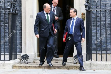 Secretary of State for Defence Ben Wallace (L) and Secretary of State for Wales Alun Cairns (R) departs from No 10 Downing Street after attending the weekly Cabinet Meeting.