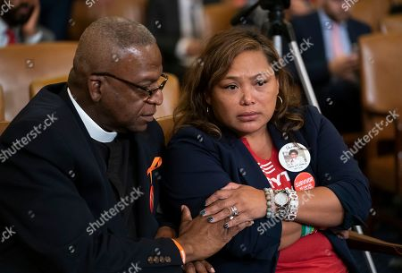 Stock Image of Jackie Jackson, Mia Livas Porter. Rev. Jackie Jackson, left, an anti-violence advocate from Cincinnati, and gun violence survivor Mia Livas Porter of Los Angeles, comfort each other as they attend a forum led by House Democrats to urge the Senate to vote on a bill that would expand background checks for gun purchases, on Capitol Hill in Washington