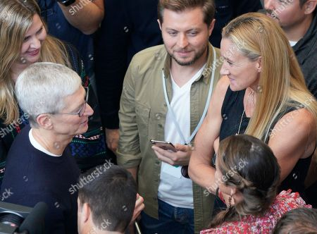 Stock Photo of Apple CEO Tim Cook, left, chats with Olympic gold medalist Kerri Walsh Jennings, right, at the Steve Jobs Theater during an event to announce new products, in Cupertino, Calif
