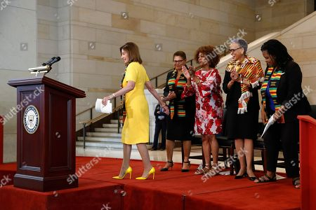 Nancy Pelosi, Johnnetta Cole, Annette Gordon-Reed, Karen Bass, Alfre Woodard. House Speaker Nancy Pelosi of Calif. walks to a podium to speak at a ceremony to commemorate the 400th anniversary of the first recorded arrival of enslaved African people in America, on Capitol Hill in Washington. Standing behind Pelosi are speakers Rep. Karen Bass, D-Calif., from left, Alfre Woodard, Johnnetta Cole and Annette Gordon-Reed