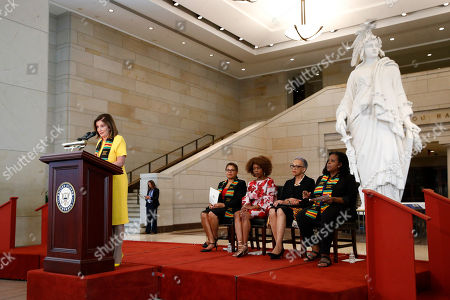 Nancy Pelosi, Johnnetta Cole, Annette Gordon-Reed, Karen Bass, Alfre Woodard. House Speaker Nancy Pelosi of Calif. speaks at a ceremony to commemorate the 400th anniversary of the first recorded arrival of enslaved African people in America, on Capitol Hill in Washington. Sitting behind Pelosi are speakers Rep. Karen Bass, D-Calif., from left, Alfre Woodard, Johnnetta Cole and Annette Gordon-Reed