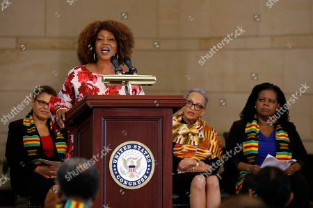 Johnnetta Cole, Annette Gordon-Reed, Karen Bass, Alfre Woodard. Actress Alfre Woodard speaks at a ceremony to commemorate the 400th anniversary of the first recorded arrival of enslaved African people in America, on Capitol Hill in Washington. Sitting behind Woodard are Rep. Karen Bass, D-Calif., from left, Johnnetta Cole and Annette Gordon-Reed
