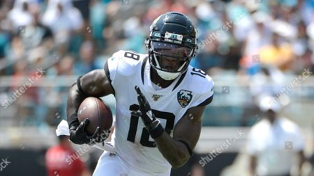 Jacksonville Jaguars wide receiver Chris Conley (18) runs after catching a pass during the first half of an NFL football game against the Kansas City Chiefs, in Jacksonville, Fla
