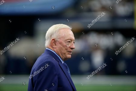Dallas Cowboys team owner Jerry Jones watches warmups before a NFL football game against the New York Giants in Arlington, Texas