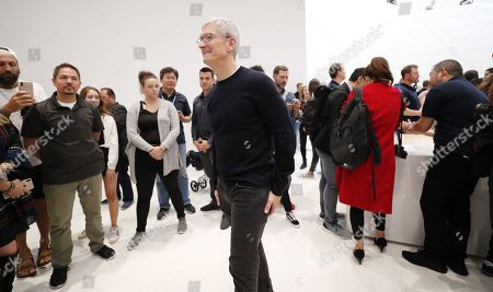 Apple CEO Tim Cook as members of the media look at new Apple products during the hands-on portion of the Apple Special Event in the Steve Jobs Theater at Apple Park in Cupertino, California, USA, 10 September 2019.