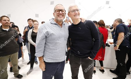 Apple CEO Tim Cook (R) and Apple Chief Design Officer Jony Ive as members of the media look at new Apple products during the hands-on portion of the Apple Special Event in the Steve Jobs Theater at Apple Park in Cupertino, California, USA, 10 September 2019.