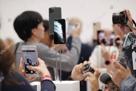 Members of the media look at new Apple products during the hands-on portion of the Apple Special Event in the Steve Jobs Theater at Apple Park in Cupertino, California, USA, 10 September 2019.