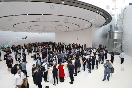 Stock Picture of Members of the media look at new Apple products during the hands-on portion of the Apple Special Event in the Steve Jobs Theater at Apple Park in Cupertino, California, USA, 10 September 2019.
