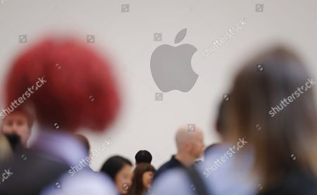 Stock Photo of Members of the media look at new Apple products during the hands-on portion of the Apple Special Event in the Steve Jobs Theater at Apple Park in Cupertino, California, USA, 10 September 2019.