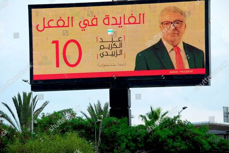 An electoral poster for Defense Minister and presidental candidate Abdelkarim Zbidi is pictured in Tunis. Tunisia's 26 presidential candidates launched their campaigns last week in a political climate marked by uncertainty, money laundering allegations and worries about violent extremism