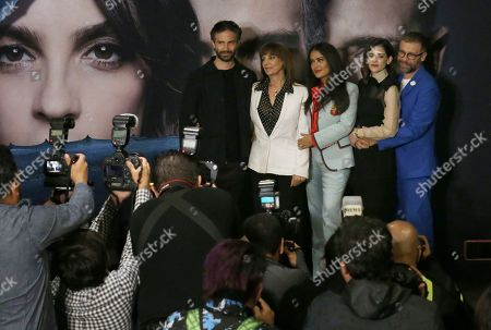 """Mexican actress and producer Salma Hayek, top center, poses for pictures with, from left, Osvaldo Bernavides, Rosa Maria Bianchi, Irene Azule and Juan Manuel Bernal during a news conference promoting her new movie """"Monarca"""" in Mexico City, . Hayek is a native of Veracruz, Mexico"""