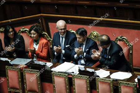 Italian premier Giuseppe Conte (2-R) claps his hands together with in Justice Minister Alfonso Bonafede and (L-R) Public Administration Minister Fabiana Dadone, Tech innovation minister Paola Pisano and Relationship with the Parliament minister Federico D'Inca ' in the Senate at the end of the confidence vote who marks the start of his second government, Rome, Italy, 10 September 2019. The votes in favour of the new government are 168, the votes against 133 and five senators didn't vote.