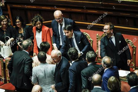 Italian premier Giuseppe Conte (2-R) reacts with in Justice minister Alfonso Bonafede and (L-R) Work minister Nunzia Catalfo, Public administration minister Fabiana Dadone, Tech innovation minister Paola Pisano and Relationship with the Parliament minister Federico D'Inca ' in the Senate at the end of the confidence vote who marks the start of his second government, Rome, Italy, 10 September 2019. The votes in favour of the new government are 168, the votes against 133 and five senators didn't vote.