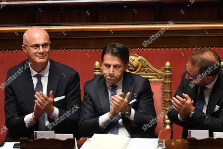 Italian premier Giuseppe Conte (2-R) claps his hands with in Justice minister Alfonso Bonafede (R) and Relationship with the Parliament minister Federico D'Inca ' (L) in the Senate at the end of the confidence vote that marks the start of his second government, Rome, Italy, 10 september 2019. The votes in favour of the new government were 168, the votes against 133 and 5 senators didn't vote.