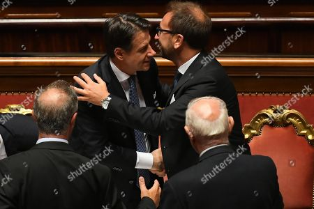 Italian premier Giuseppe Conte (L) hugs Justice minister Alfonso Bonafede in the Senate at the end of the confidence vote that marks the start of his second government in Rome, Italy, 10 September 2019. The votes in favour of the new government were 168, the votes against 133 and 5 senators didn't vote.