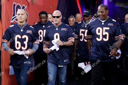 Stock Photo of Former Chicago Bears quarterback Jim McMahon (9) and other members of the Super Bowl XX Championship Chicago Bears team are honored before the NFL game between the Green Bay Packers, in Chicago. Green Bay won the game 10-3