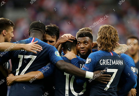 France's Wissam Ben Yedder (C) is congratulated by teammate Thomas Lemar (C-R) after scoring the 3-0 lead during the UEFA EURO 2020 qualifying soccer match between France and Andorra in Saint-Denis, near Paris, France, 10 September 2019.