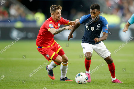 France's Thomas Lemar (R) and Andorra's Marc Rebes (L) in action during the UEFA EURO 2020 qualifying soccer match between France and Andorra in Saint-Denis, near Paris, France, 10 September 2019.