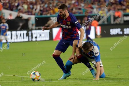 Barcelona forward Abel Ruiz, left, goes for the ball as Napoli midfielder Piotr Zielinski defends during the second half of a LaLiga-Serie A Cup soccer match, in Miami Gardens, Fla. Barcelona won 2-1
