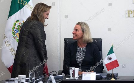 Federica Mogherini, top foreign policy official for the European Union, right, talks with Mexican Senator Claudia Ruiz Massieu as she visits lawmakers at the Senate in Mexico City