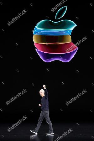Apple CEO Tim Cook waves to the crowd as he leaves the stage for an event to announce new products, in Cupertino, Calif