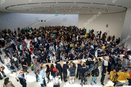 Event attendees get a look at the new products at the Steve Jobs Theater during an event to announcement, in Cupertino, Calif