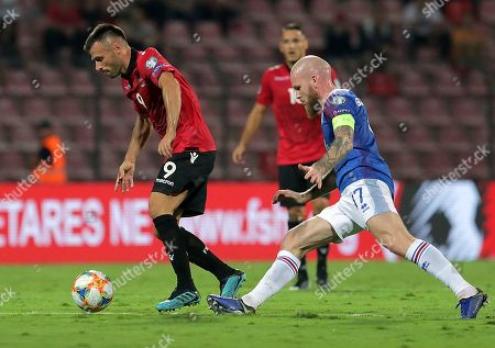 Albania;s Ledian Memushaj (L) and Iceland's Aron Gunnarsson (R) in action during the UEFA EURO 2020 group H qualify soccer match between Albania and Iceland in Elbasan, Albania, 10 September 2019.