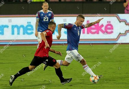 Iceland's Ragnar Sigurdsson (R) in action during the UEFA EURO 2020 group H qualify soccer match between Albania and Iceland in Elbasan, Albania, 10 September 2019.