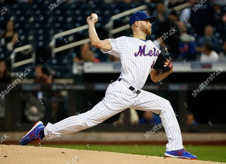 New York Mets starting pitcher Zack Wheeler winds up during the first inning of the team's baseball game against the Arizona Diamondbacks, in New York