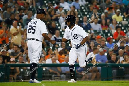 Stock Picture of Detroit Tigers' Christin Stewart celebrates his solo home run with third base coach Dave Clark (25) in the fifth inning of a baseball game against the New York Yankees in Detroit