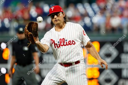 Philadelphia Phillies starting pitcher Jason Vargas fields a ground out by Atlanta Braves' Josh Donaldson during the first inning of a baseball game, in Philadelphia
