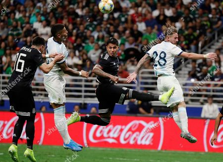 Stock Picture of Hector Herrera, Carlos Salcedo, Faustino Marcos Rojo, Alexis Mac Allister. Mexico's Hector Herrera (16) and Carlos Salcedo, second from right, defend as Argentina's Faustino Marcos Rojo, second from left, and Alexis Mac Allister (28) attempt to score during the second half of an international friendly soccer match, in San Antonio