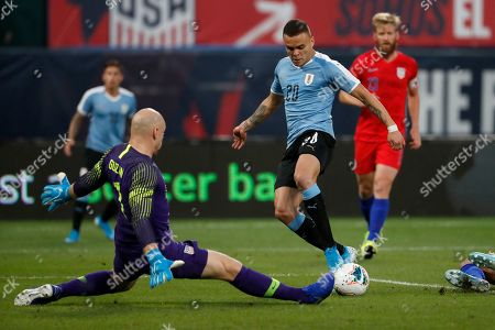 Stock Photo of Uruguay's Jonathan Rodriguez (20) is unable to score past United States goalkeeper Brad Guzan during the first half of a friendly soccer match, in St. Louis
