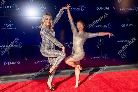 Nadia Comaneci, Katelyn Ohashi. Nadia Comaneci, left, and Katelyn Ohashi attend the Laureus Fashion Show Gala featuring sports stars at Mercedes-Benz Manhattan, in New York