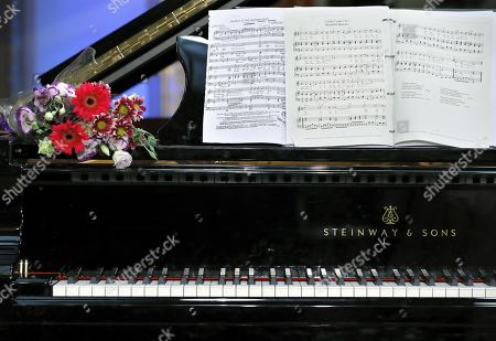 A bunch of flowers and the Cielito Lindo score (R) lay on a piano shortly after a recital performed by Mexican-born French tenor Rolando Villazon and Canadian pianist Carrie-Ann Matheson at the Romanian Athenaeum concert hall during the George Enescu International Festival 2019 in Bucharest, Romania, 10 September 2019. The festival, held every two years since 1958, is the biggest classical music festival held in Romania, and is named after Romanian composer and violinist George Enescu.