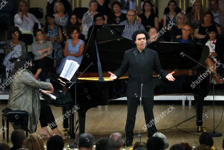 Mexican-born French tenor Rolando Villazon (C), accompanied by Canadian pianist and conductor Carrie-Ann Matheson (L), performs on the stage during the George Enescu International Festival 2019 at the Grand Concert Hall in Bucharest, Romania, 10 September 2019. The festival, held every two years since 1958, is the biggest classical music festival held in Romania, and is named after Romanian composer and violinist George Enescu.