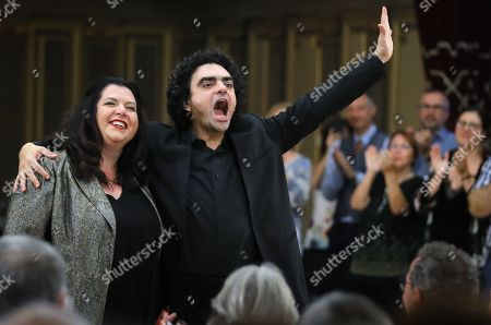 Stock Photo of Mexican-born French tenor Rolando Villazon (R), accompanied by Canadian pianist and conductor Carrie-Ann Matheson (L), greets the audience on the stage during the George Enescu International Festival 2019 at the Grand Concert Hall in Bucharest, Romania, 10 September 2019. The festival, held every two years since 1958, is the biggest classical music festival held in Romania, and is named after Romanian composer and violinist George Enescu.
