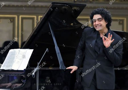 Stock Picture of Mexican-born French tenor Rolando Villazon performs on stage during the George Enescu International Festival 2019 at the Grand Concert Hall in Bucharest, Romania, 10 September 2019. The festival, held every two years since 1958, is the biggest classical music festival held in Romania, and is named after Romanian composer and violinist George Enescu.