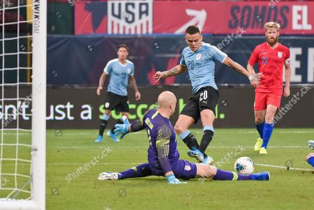 Stock Image of US Men's National Team goalkeeper Brad Guzan (1) slides out to make a save on Uruguay forward Jonathan Rodriquez (20) during the final match before the Concacaf Nations League as the United States Men's National Team hosted Uruguay at Busch Stadium in St. Louis City, MO Ulreich/CSM
