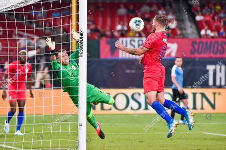 US Men's National Team forward Jordan Morris (11) deflects the ball with his chest past Uruguay goalkeeper Fernando Muslera (1) for a goal to tie the game up at 1 to 1 during the final match before the Concacaf Nations League as the United States Men's National Team hosted Uruguay at Busch Stadium in St. Louis City, MO Ulreich/CSM
