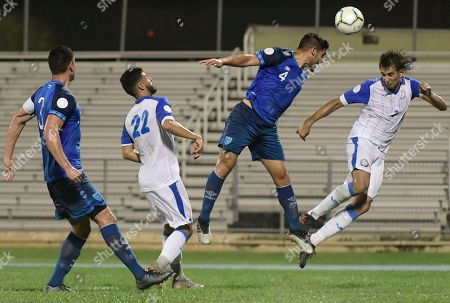 Guatemala's Jose Pinto (4) and Puerto Rico's Joshua Calderon, right, go for a header during the first half of the CONCACAF Nations League qualifying soccer match in Mayaguez, Puerto Rico