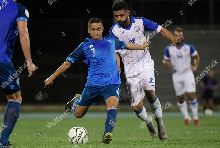 Guatemala's Marvin Ceballos, left, and Puerto Rico's Jose Calderon vie for the ball during the first half of the CONCACAF Nations League qualifying soccer match, in Mayaguez, Puerto Rico