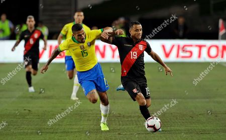 Yoshimar Yotun, Allan. Peru's Yoshimar Yotun, right, is defended by Brazil's Allan during the first half of an international friendly soccer match, in Los Angeles