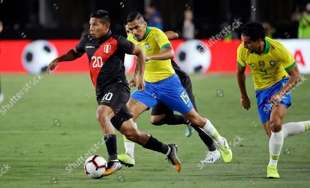 Edison Flores, Allan, Eden Militao. Peru's Edison Flores, left, dribbles past Brazil's Allan, center, and Marquinhos, right, during the first half of an international friendly soccer match, in Los Angeles