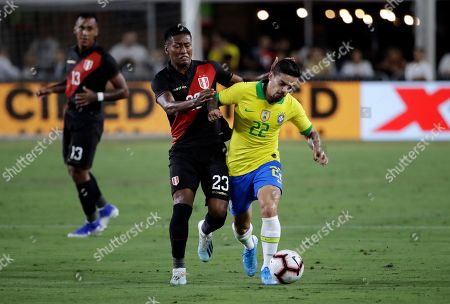 Fagner, Pedro Aquino. Brazil's Fagner, right, is defended by Peru's Pedro Aquino during the first half of an international friendly soccer match, in Los Angeles
