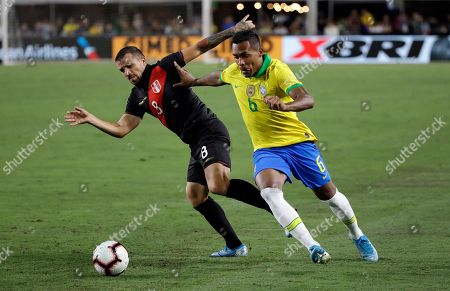 Alex Sandro, Gabriel Costa. Brazil's Alex Sandro, right, is defended by Peru's Gabriel Costa during the second half of an international friendly soccer match, in Los Angeles